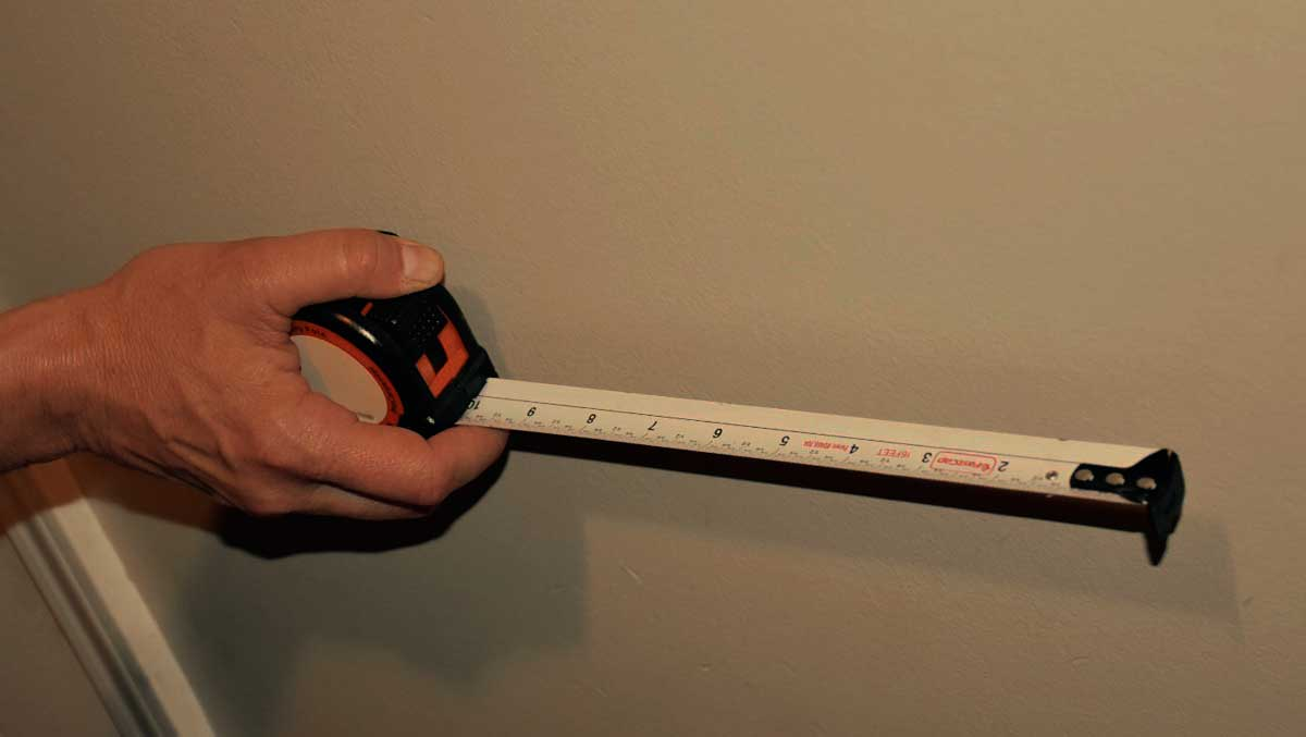 Use a tape measure to measure the walls