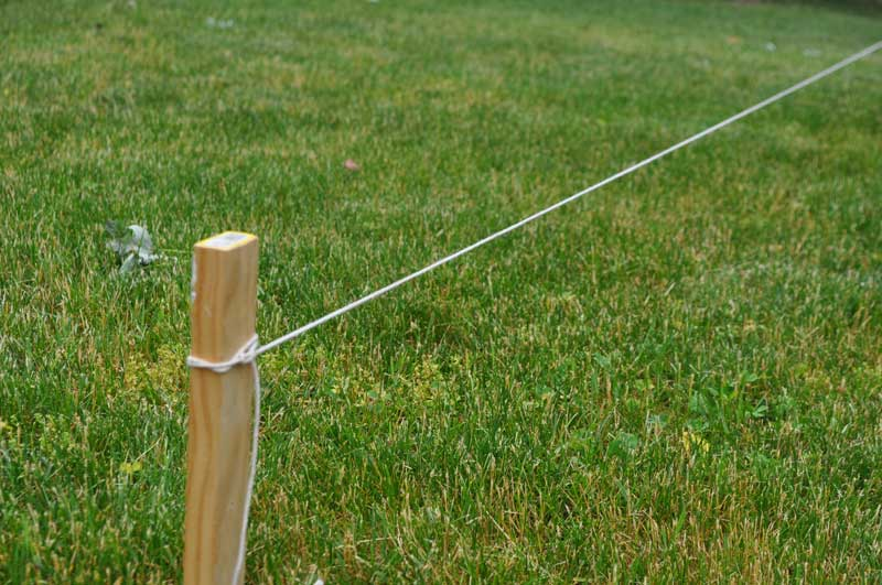 String attached to fence layout stake to  locate the fence line