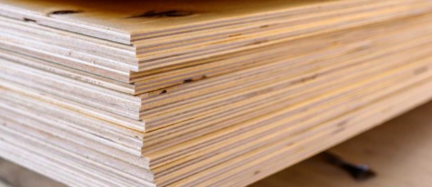 A stack of plywood sheets at a lumber yard