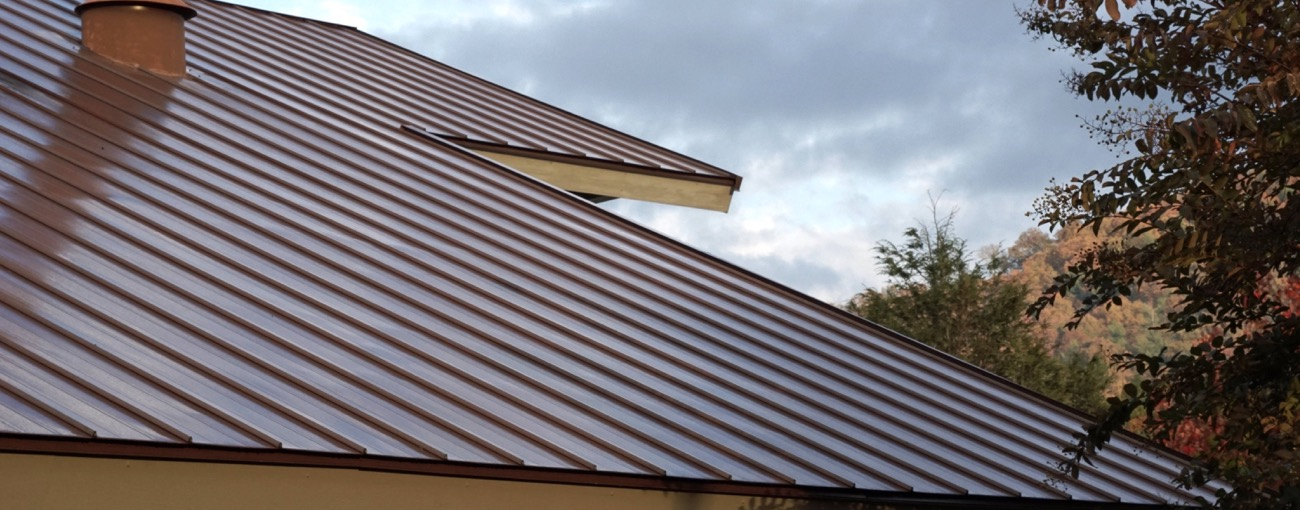 Home with a metal roof. Metal roofs are beautiful, very durable, and last a long time.