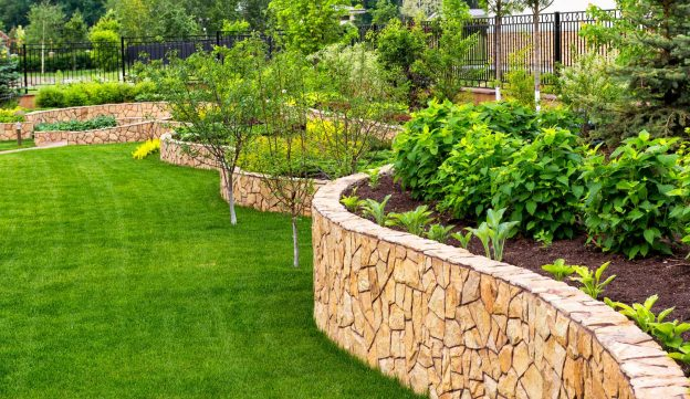 Beautifully manicured landscaping and retaining wall