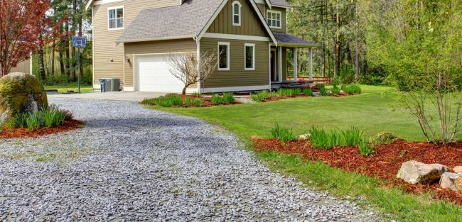long gravel driveway at a country home