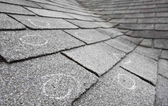 damaged roof that needs to be repaired