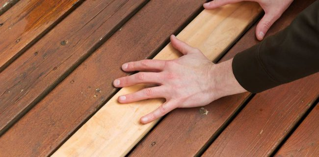 Deck with repaired deck boards