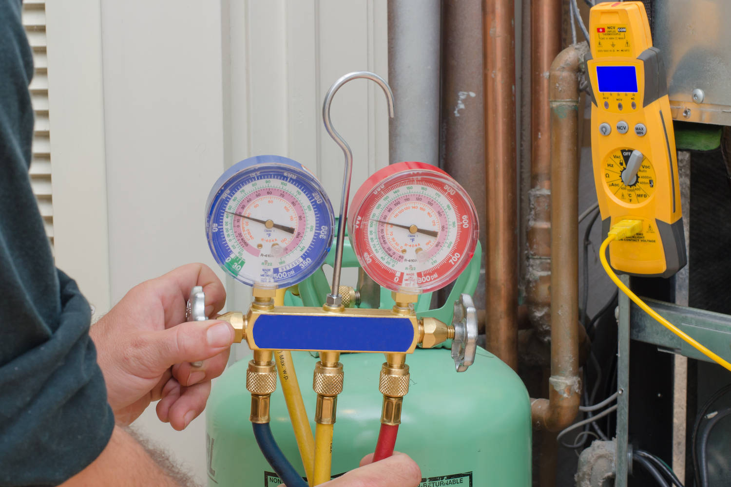 Refrigerant tank and gauges for charging a residential heat pump