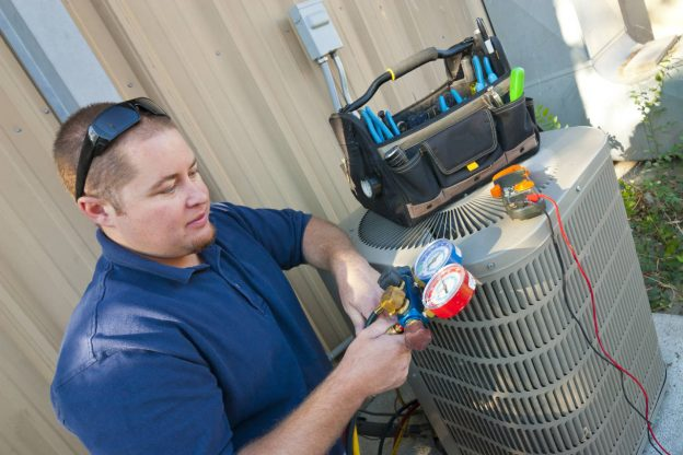 technician repairing an air conditioner