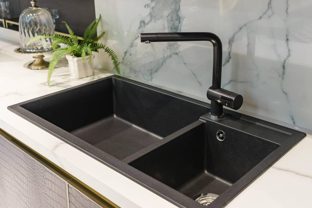 newly installed black enamel cast iron sink in a kitchen