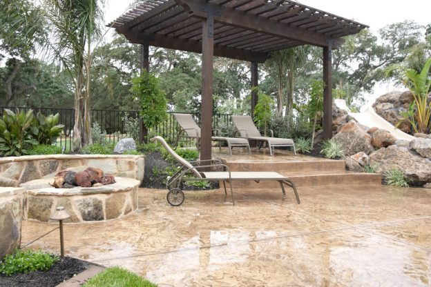 Concrete patio with tan color and stamped pattern