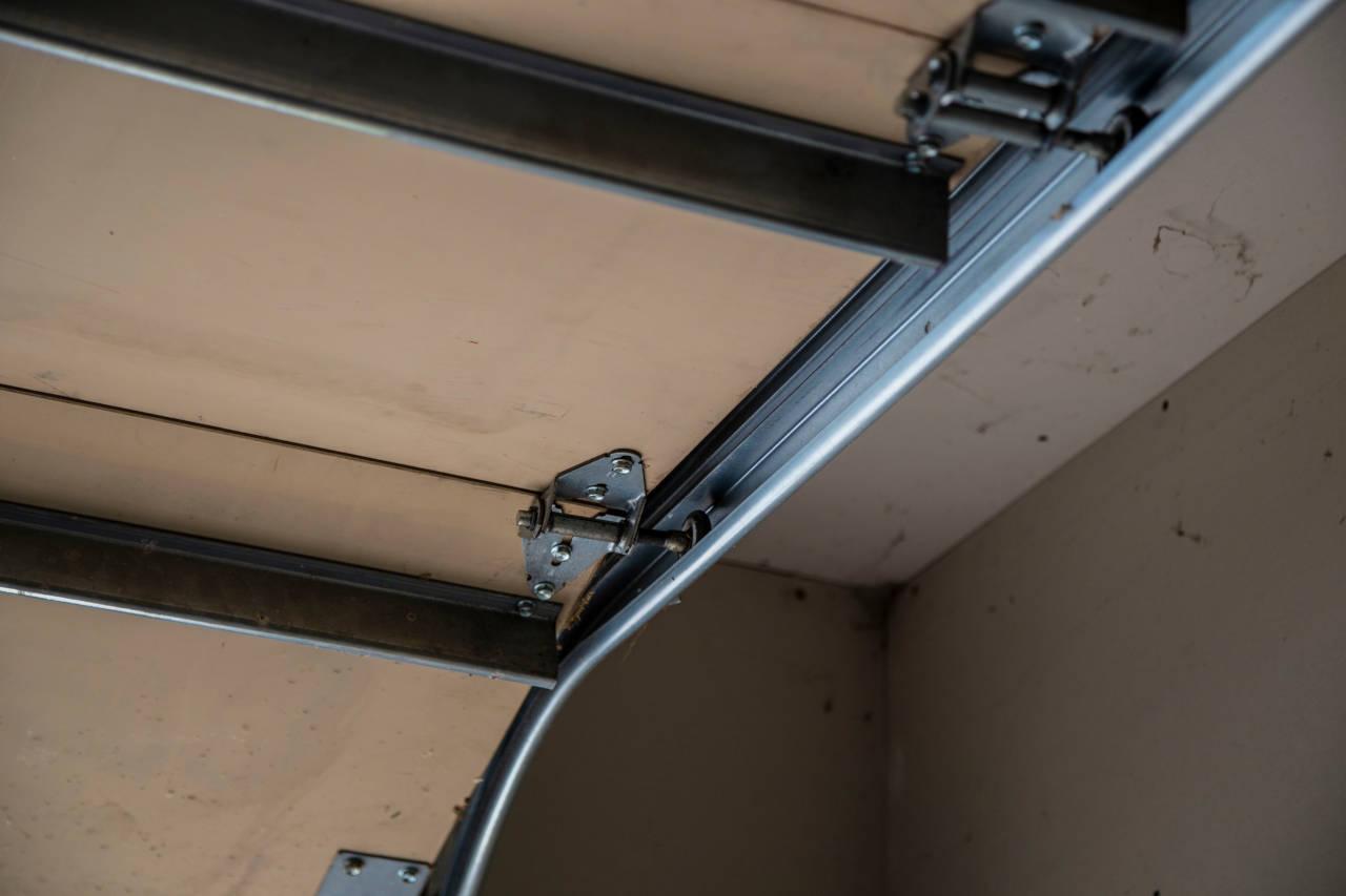 damaged garage door in need of repair