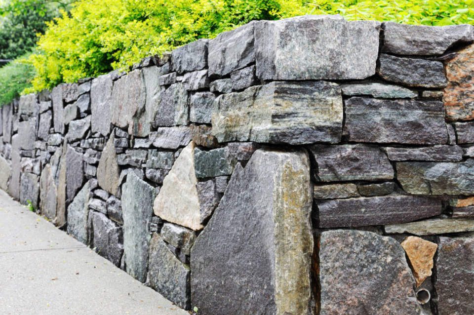 Stone retaining walls are beautiful but materials are usually more expensive