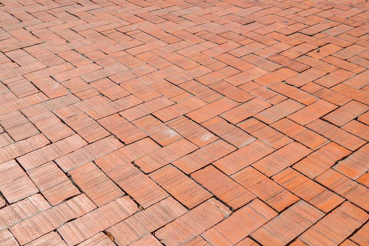 A brick patio is extremely beautiful and can be constructed from historic reclaimed brick or modern concrete bricks.