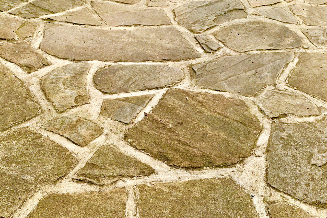 Flagstones are a great patio material, but are often the most expensive choice as they are the most difficult to install