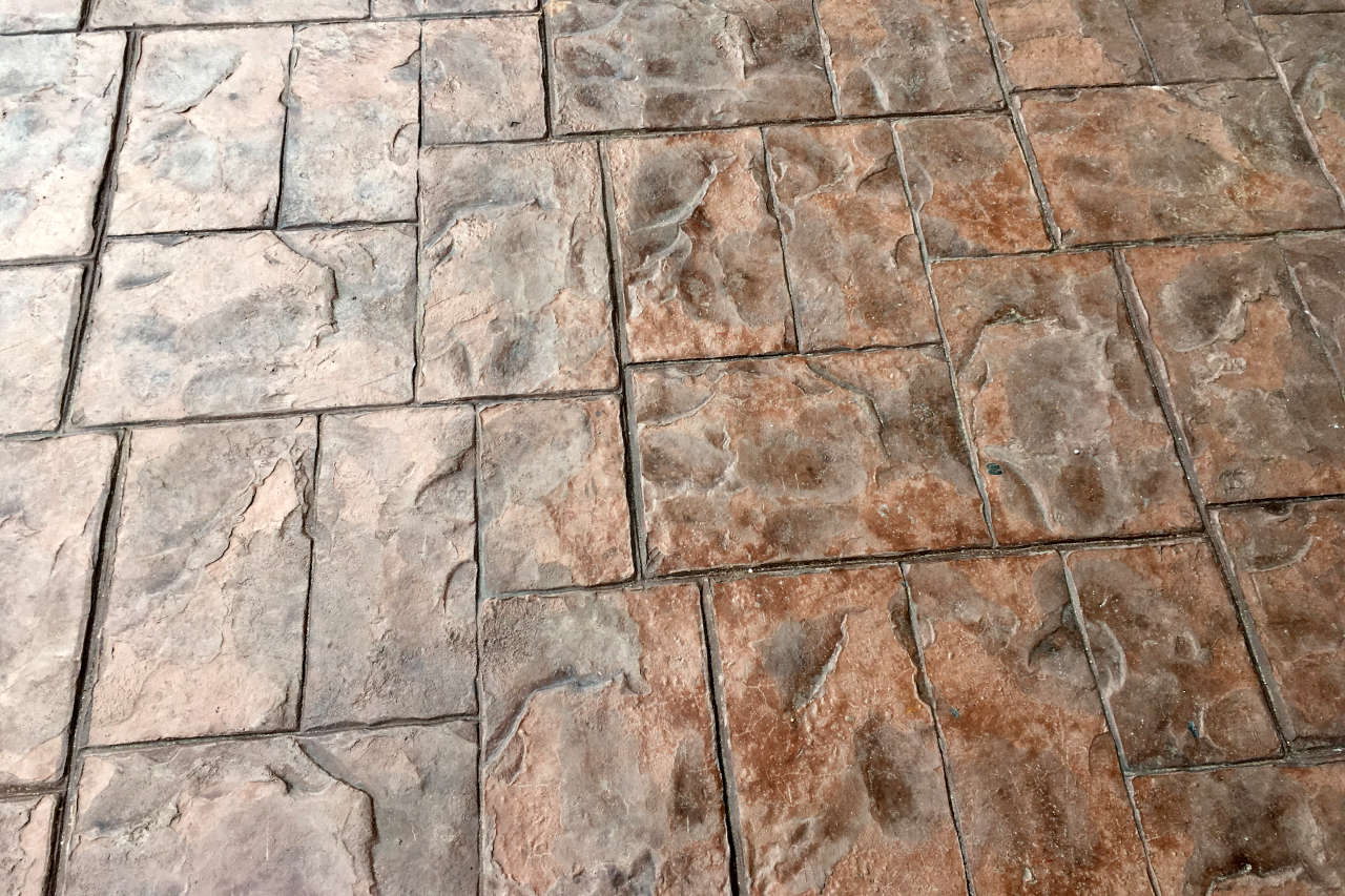 Concrete is a cost effective material for your patio and can be colored and stamped to look like natural stone