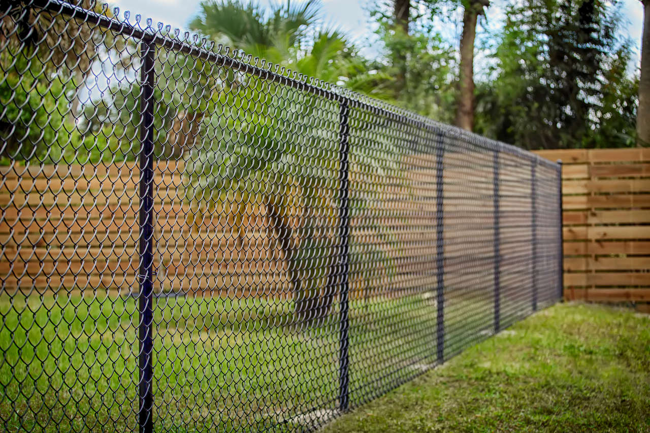 Chain link is a very cost effective material choice for a fence