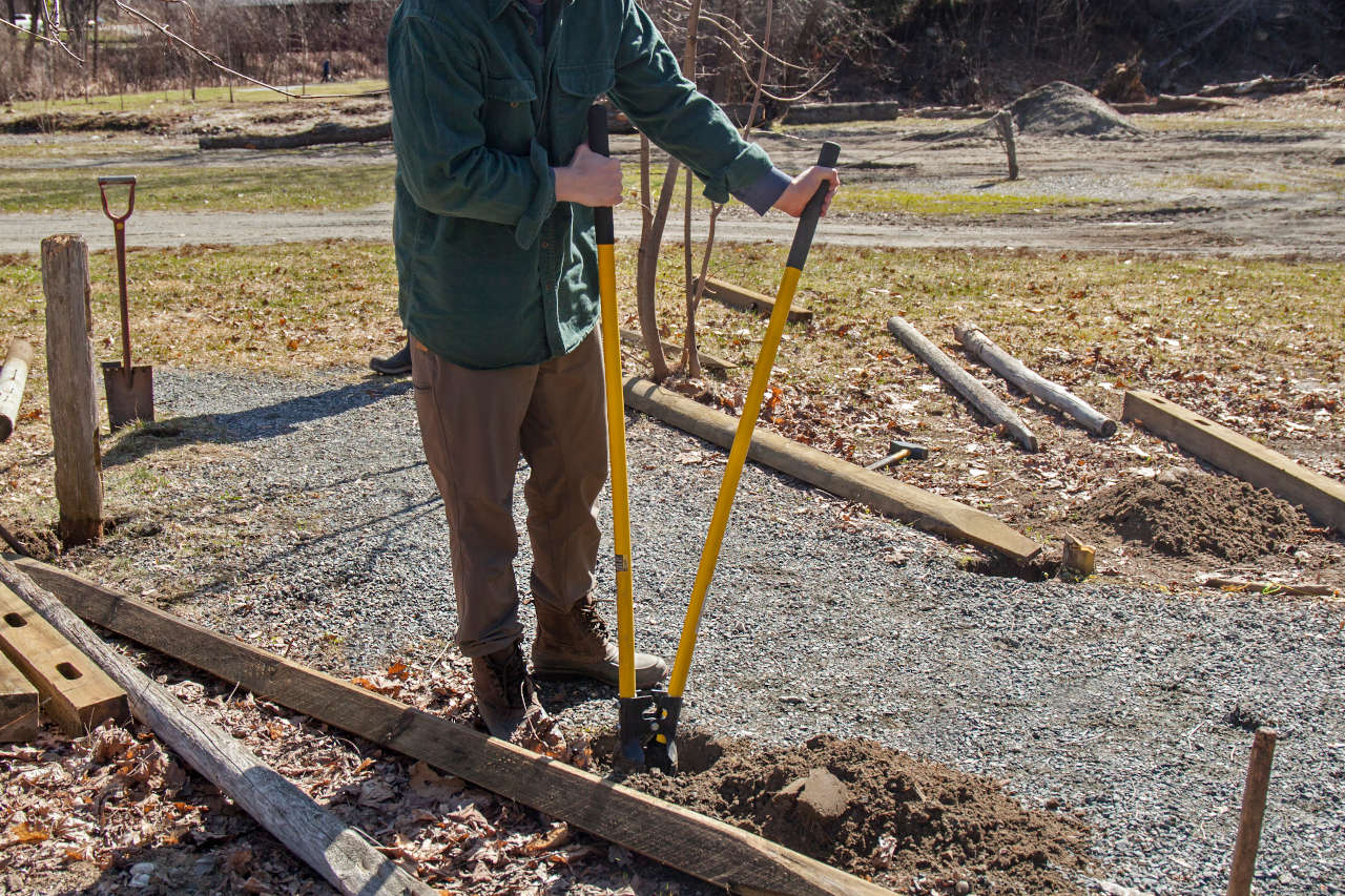 Make sure the fence posts are plumb in all directions and then add post-setting concrete