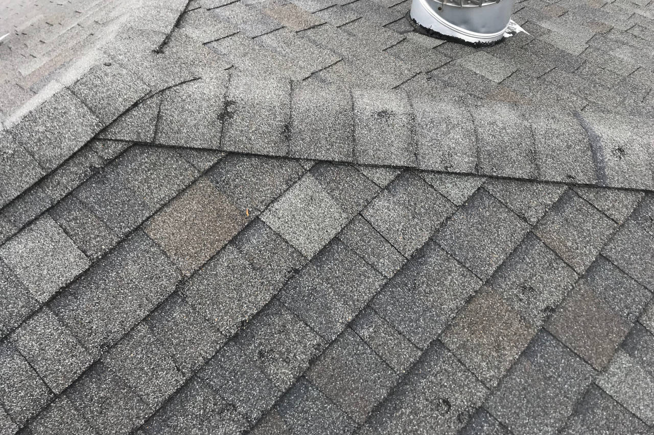 shingles with major dark spots from missing granules