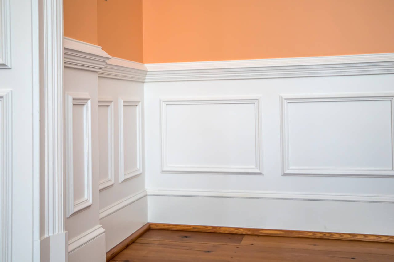 Wainscoting consists of horizontal rails, vertical stiles, and panels that are often laid out with even spacing and widths.