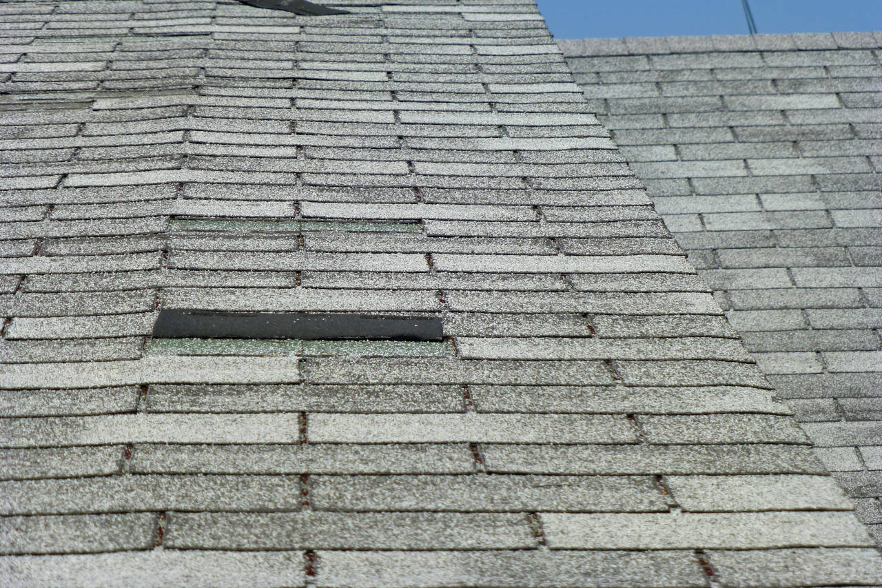 asphalt shingles showing signs of wear