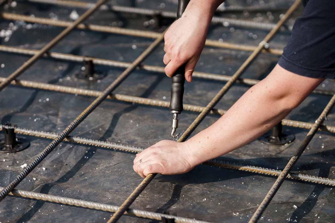 Rebar is installed in a grid pattern to reinforce concrete slabs and prevent cracking